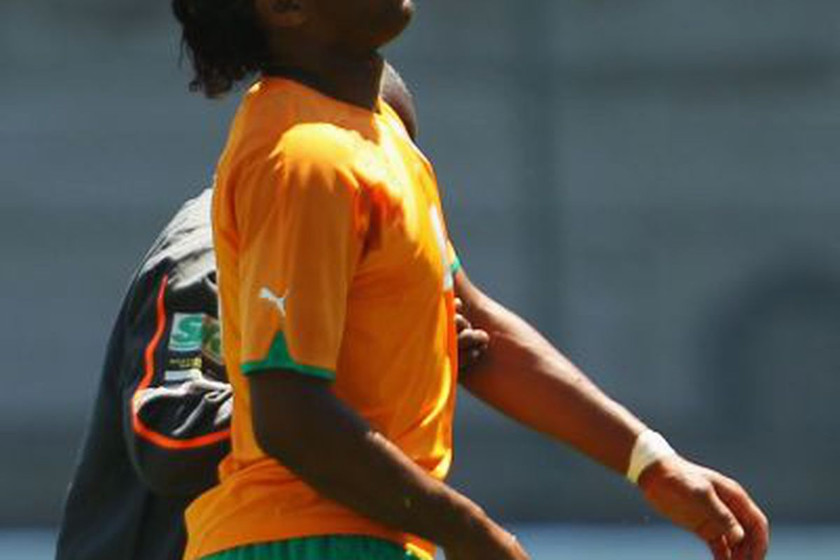 Didier Drogba is helped off the field during an Ivory Coast friendly with Japan. Photo courtesy of Chelsea FC.