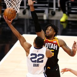 Utah Jazz center Derrick Favors (15) defends Memphis Grizzlies guard Desmond Bane (22) as the Utah Jazz and Memphis Grizzlies play Game 2 of their NBA playoffs first round series at Vivint Arena in Salt Lake City on Wednesday, May 26, 2021.