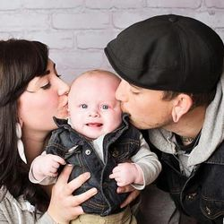 Brad Hancock, 23, was shot and killed outside of a concert in the parking lot of At The Core Nov. 15, 2014. Here, he is pictured with his fiancé, Mariah Borg, and their son.