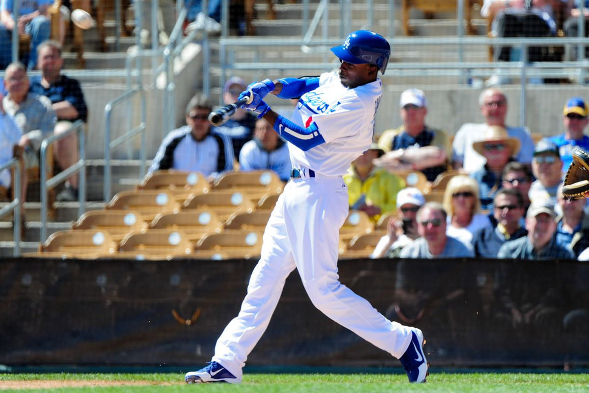 Mar. 20, 2012; Glendale, AZ, USA; Los Angeles Dodgers shortstop Dee Gordon (9) hits a triple during the first inning against the Milwaukee Brewers at Camelback Ranch. Mandatory Credit: Matt Kartozian-US PRESSWIRE