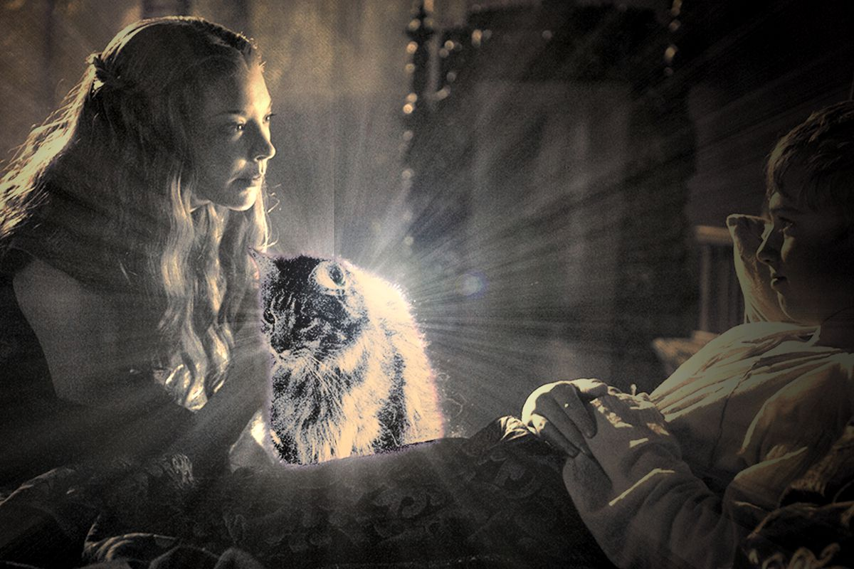 Margaery and Ser Pounce, a cat, sitting on Tommen Baratheon's bed in 'Game of Thrones'