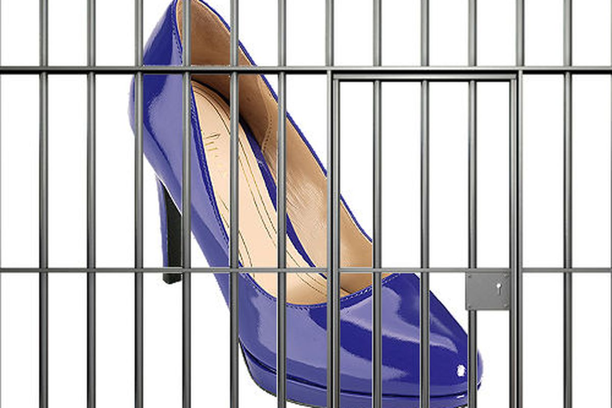 """Jail bars via <a href=""""http://www.shutterstock.com/pic-108487787/stock-photo-a-front-view-of-the-bars-of-a-jail-cell-with-iron-bars-and-a-door-on-an-isolated-background.html?src=csl_recent_image-1"""">albund</a>/Shutterstock"""
