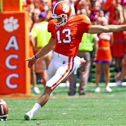 Clemson's Spencer Benton kicks off in the first half of an NCAA college football game against Ball State on Saturday, Sept. 8, 2012 in Clemson, S.C. Benton kicked a 61-yard field goal at the end of the first half to set a school and Atlantic Coast Conference record.