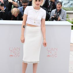 Kristen Stewart at the 'Café Society' photo call wearing a Chanel spring 2016 skirt, a Chanel fall 2016 T-shirt, and Christian Louboutin pumps.