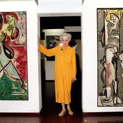 FILE - In this May 30, 1979, file photo, American art collector Peggy Guggenheim poses between early paintings by Jackson Pollock that are part of her modern art collection at her 18th century palace, Palazzo Venier dei Leoni, in Venice, Italy.  Pollock, who would have turned 100 in 2012, will have the anniversary of his birth observed with exhibitions, fundraisers and other events throughout the year.