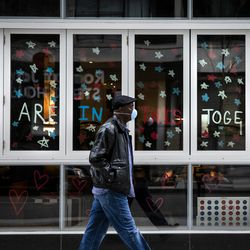 """""""We are in this together"""" written in the windows of Aloft Chicago Mag Mile, 243 E. Ontario St., during the coronavirus pandemic, Monday afternoon, April 6, 2020."""