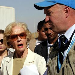 Quentin Bryce, the Australian Governor-General, left, tours the Zaatari Syrian Refugee Camp, along with UNHCR representative to Jordan, Andrew Harper, right, in Mafraq, Jordan, Sunday, Sept. 2, 2012. Bryce told the press that Australia has contributed 20 million in funds to support the refugees.