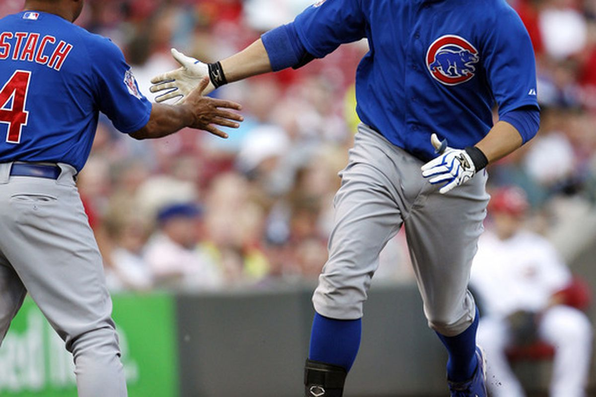 Cincinnati, OH, USA; Chicago Cubs first baseman Bryan LaHair is congratulated by third base coach Pat Listach after hitting a home run against the Cincinnati Reds at Great American Ballpark. Credit: Frank Victores-US PRESSWIRE
