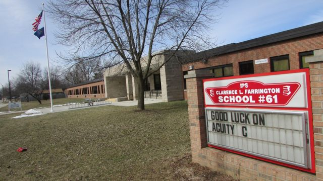 School 61's grade moved up to a D in 2014 but its test scores still rank among the district's lowest.
