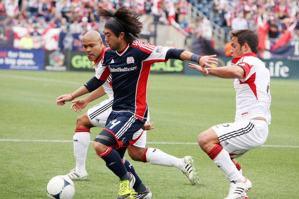 FOXBORO, MA - APRIL 14:  Lee Nguyen #24 of the New England Revolution gets past the DC United defense in the first half at Gillette Stadium April 14, 2012 in Foxboro, Massachusetts. (Photo by Gail Oskin/Getty Images)