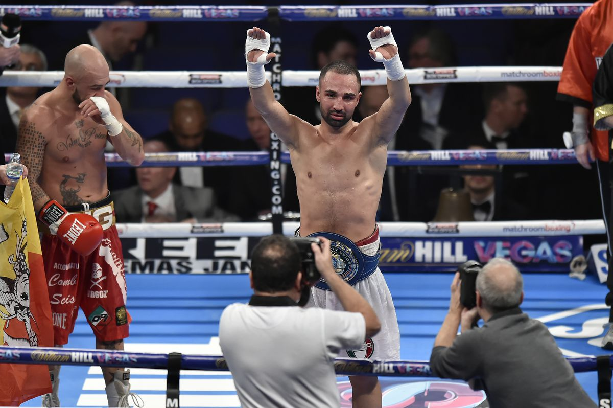 Paulie Malignaggi raises his arms in celebration of winning the European Union Welterweight title in 2015