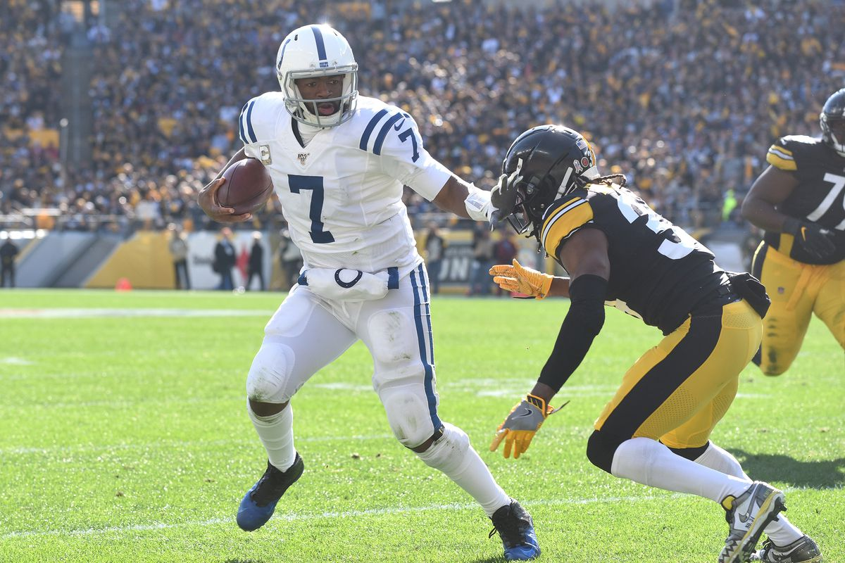 Indianapolis Colts quarterback Jacoby Brissett is pursued by Pittsburgh Steelers linebacker Bud Dupree during the first quarter at Heinz Field.