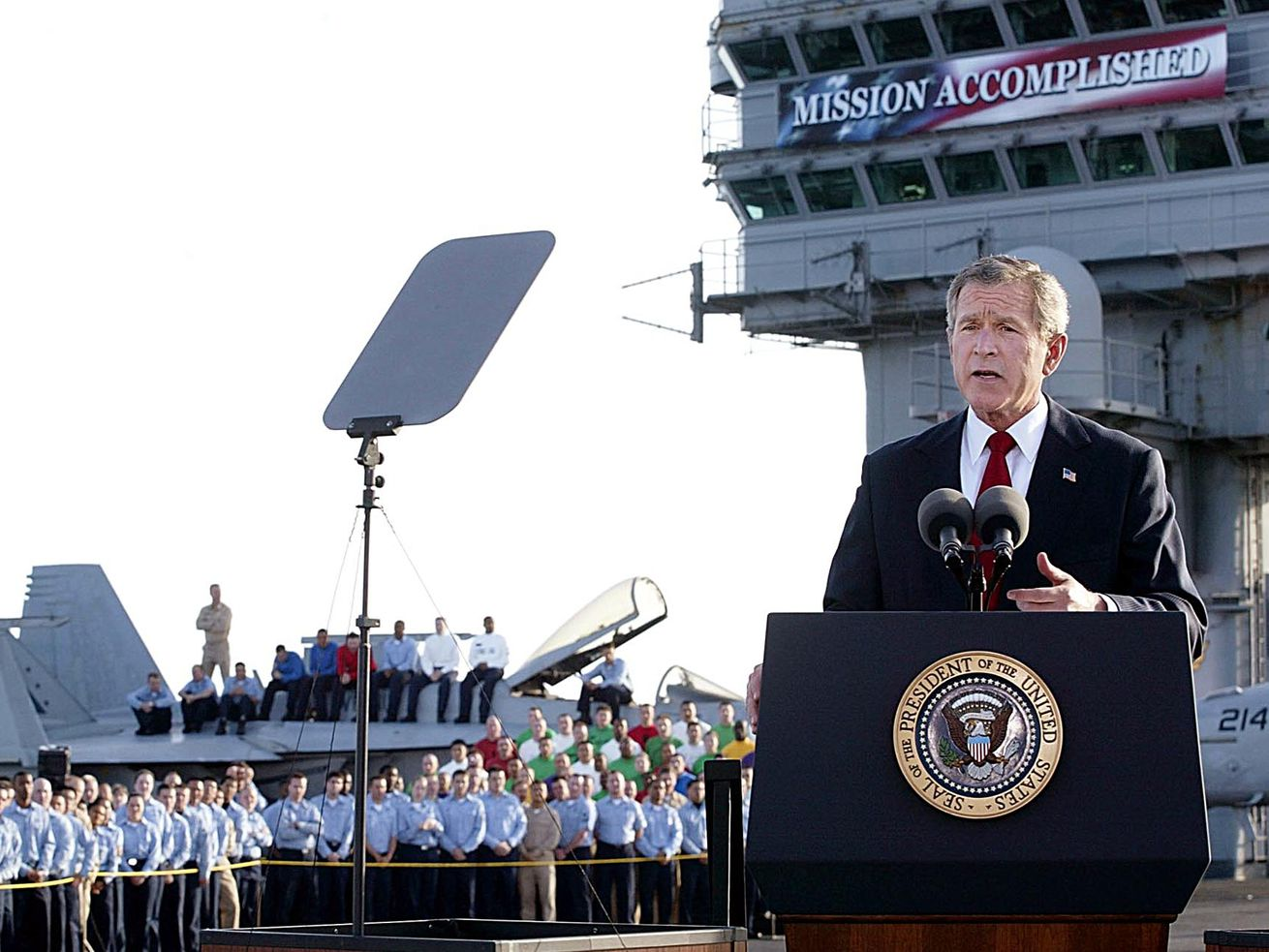 Former President George W. Bush addresses the nation aboard the nuclear aircraft carrier USS Abraham Lincoln May 1, 2003, as it sails for Naval Air Station North Island, San Diego, California.