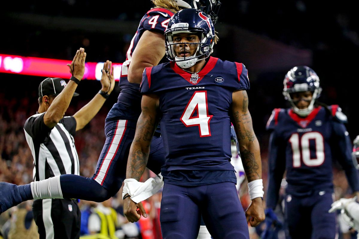 Houston Texans quarterback Deshaun Watson celebrate after scoring a touchdown during the third quarter against the Buffalo Bills in the AFC Wild Card NFL Playoff game at NRG Stadium.