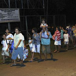 Residents of Tandag city, Surigao Del Sur province in southern Philippines, flee to higher grounds Friday, Aug. 31, 2012, following a 7.6-magnitude earthquake that struck eastern and southern Philippines. The quake set off car alarms, shook items off shelves and sent many coastal residents fleeing for high ground before the Pacific Tsunami Warning Center lifted all tsunami alerts it had issued for the Philippines and neighboring countries from Indonesia to Japan, and for Pacific islands as far away as the Northern Marianas.