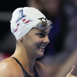Rhyan White reacts after winning the women's 200 backstroke during wave 2 of the U.S. Olympic Swim Trials on Saturday, June 19, 2021, in Omaha, Neb.