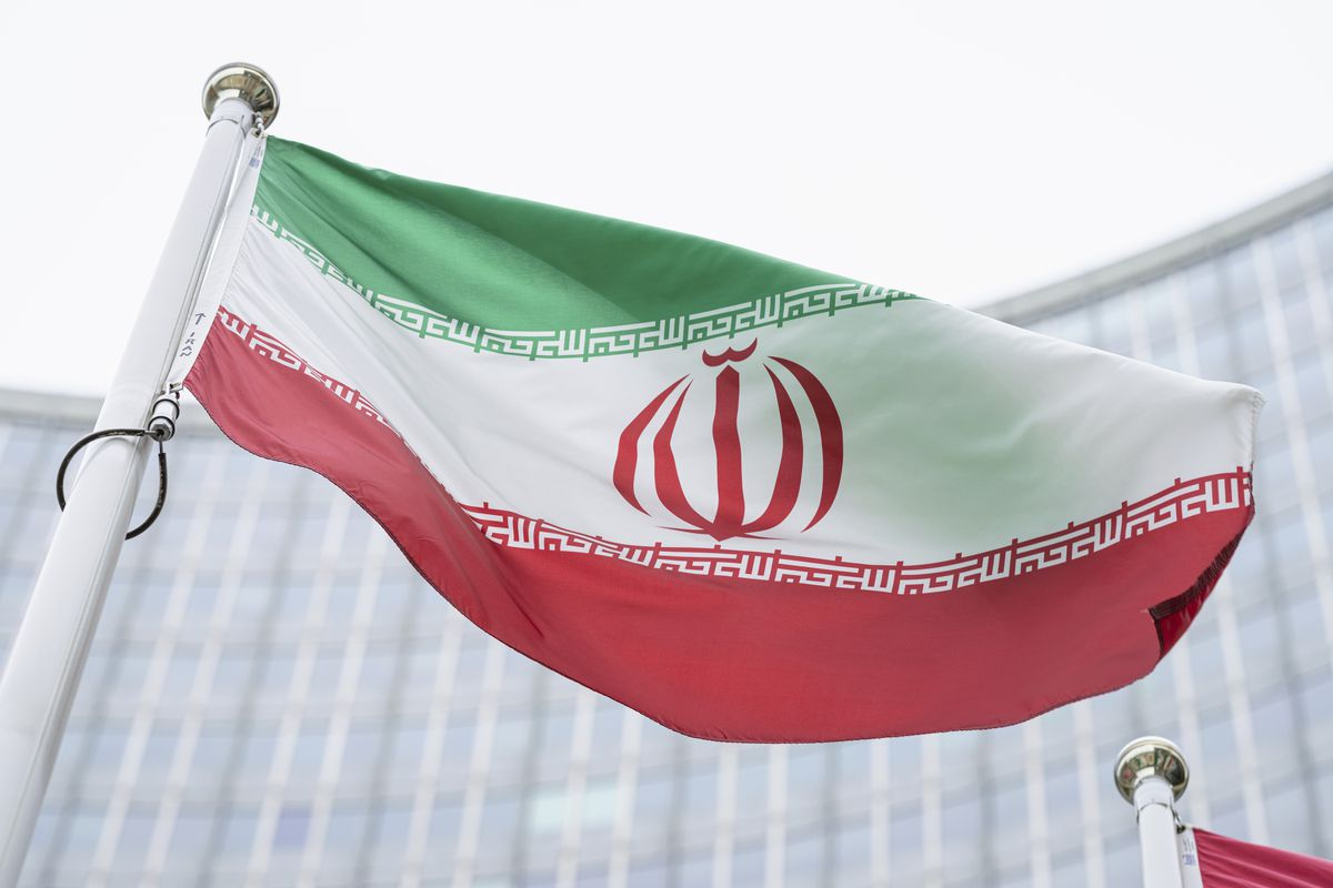 In this Monday, May 24, 2021 file photo, the flag of Iran waves in front of the the International Center building with the headquarters of the International Atomic Energy Agency, IAEA, in Vienna, Austria, Monday, May 24, 2021.