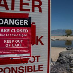 A sign indicates the closure of Utah Lake at Lincoln Beach, West of Spanish Fork, on Wednesday, July 27, 2016. Public health officials are monitoring the state of an algal bloom that has forced the closure of Utah Lake.
