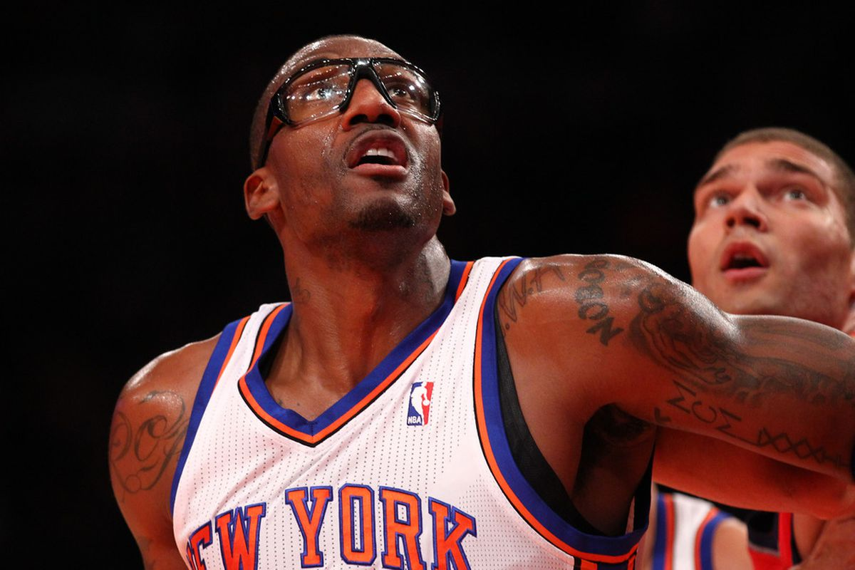 Amare Stoudemire of the New York Knicks goes for a rebound during the pre season game against the New Jersey Nets  at Madison Square Garden on December 21, 2011 in New York City.(Photo by Al Bello/Getty Images)