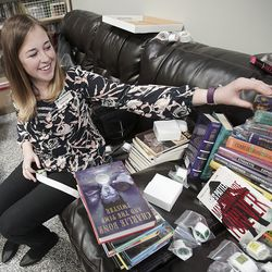 Rachel Cook, Utah State Library grants coordinator, puts category stickers on new books at the Odyssey House Adolescent Residential Center in Salt Lake City on Wednesday, Oct. 30, 2019.Staff from the state library division are using a federal grant to redo the library at the center to add age-specific books for the teens in treatment.
