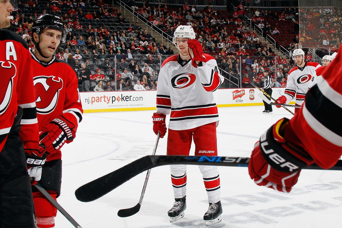 Middle: The game winning goal scorer.  Around: Unhappy Devils and many Devils fans heading for the exits.