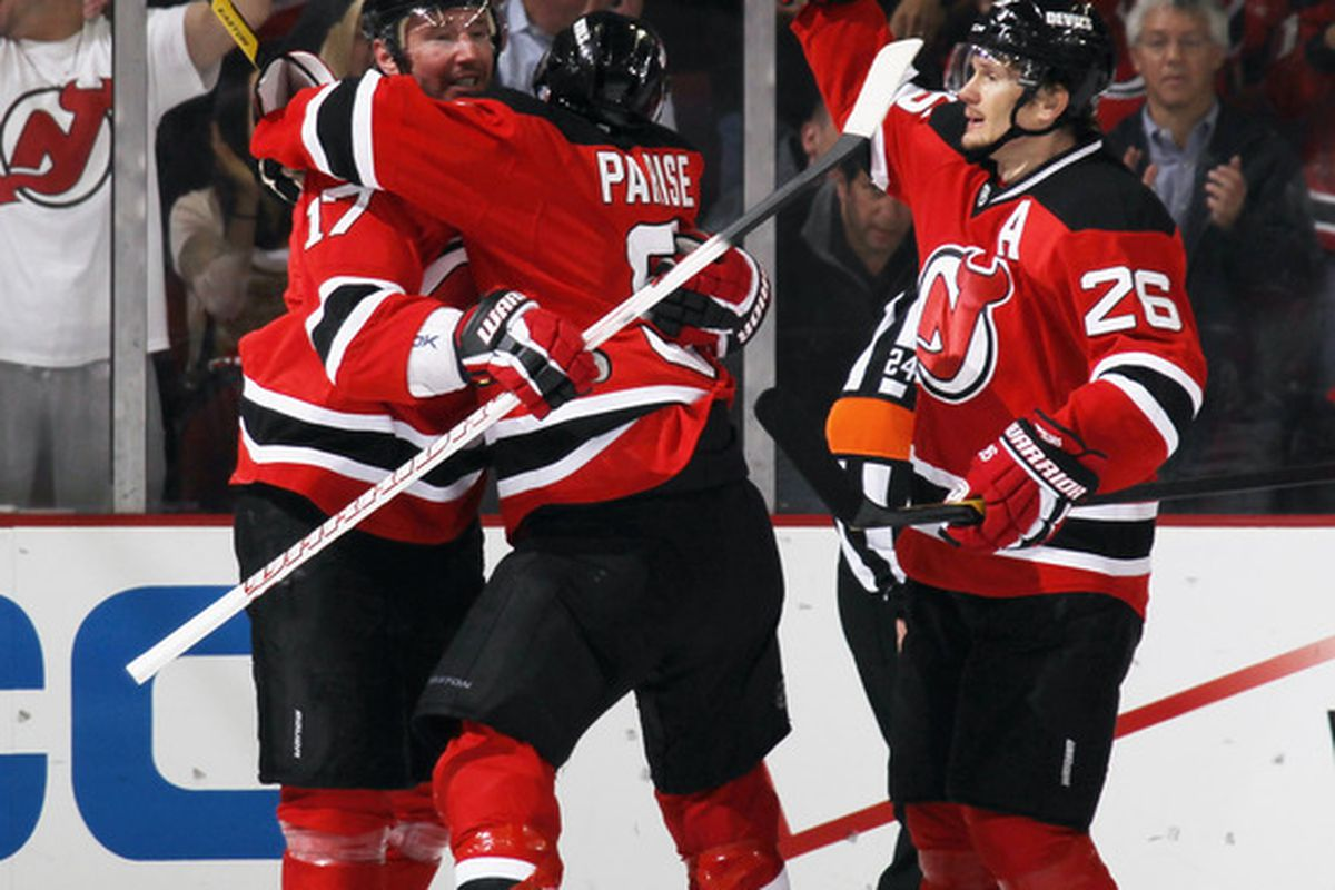 Devils hugging other Devils while cheering. That's what we want to see several times in Game 5.  (Photo by Bruce Bennett/Getty Images)