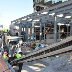 Concrete being transferred under the left center field bleachers -