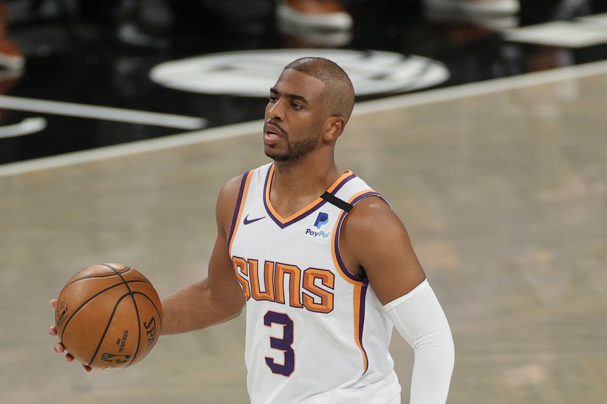Chris Paul #3 of the Phoenix Suns dribbles during the first half against the Brooklyn Nets at Barclays Center on April 25, 2021 in the Brooklyn borough of New York City.