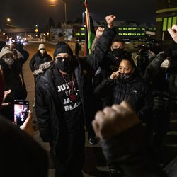 Justin Blake, Jacob Blake's uncle, leads dozens on a march and protest around Kenosha after District Attorney Michael Graveley announced that no charges will be filed against the Kenosha police officer who shot Jacob Blake, Tuesday night, Jan. 5, 2021.