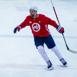 Tom Wilson smiles after scoring a goal at Capitals morning skate.