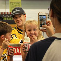 Viktor Arvidsson poses with some young fans after serving up some Italian ice at Rita's in Nolensville.