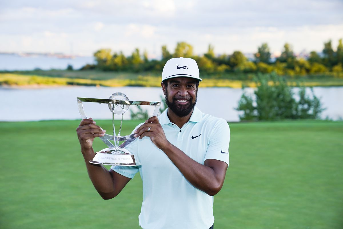 Tony Finau poses with the trophy