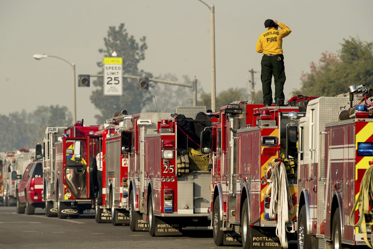 Firefighter Mike Warren, part of a Portland, Ore., crew, battling the Thomas fire, stages in Ojai, Calif., on Thursday, Dec. 7, 2017.