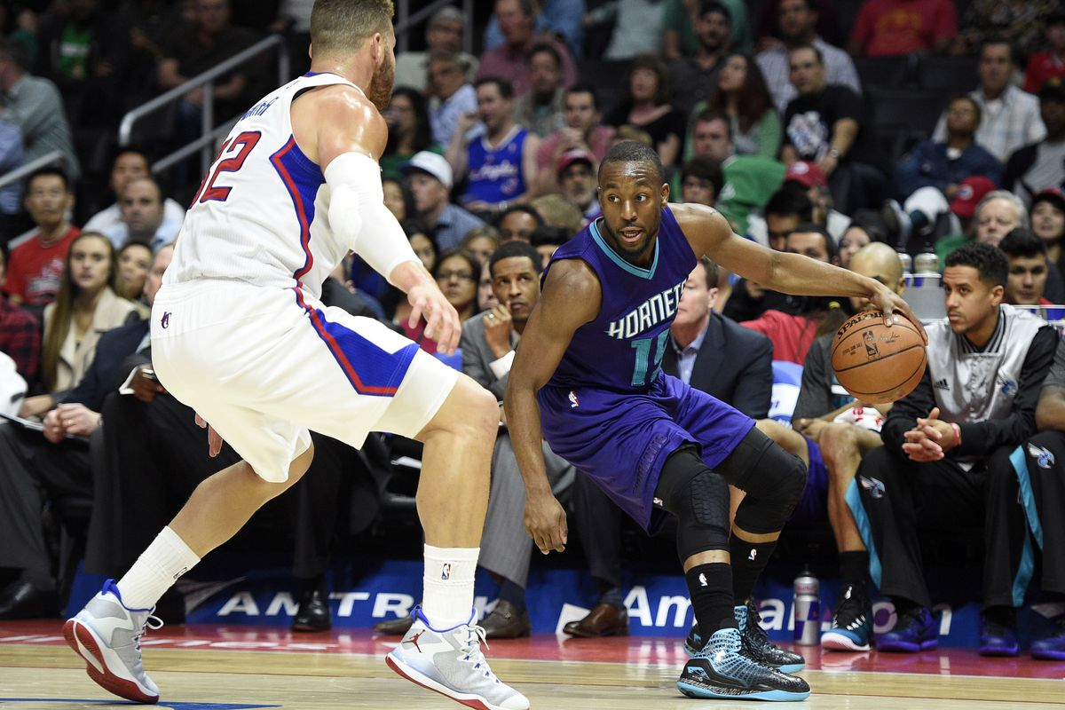 No pictures from the game in China were available, so here's Kemba Walker about to cross up Blake Griffin last season.