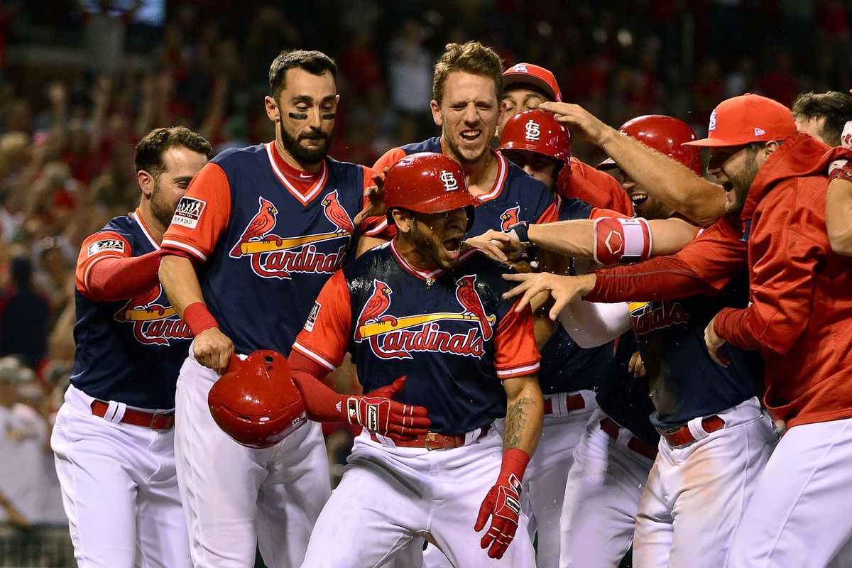 Tommy Pham is greeted by his teammates as he crosses home plate.