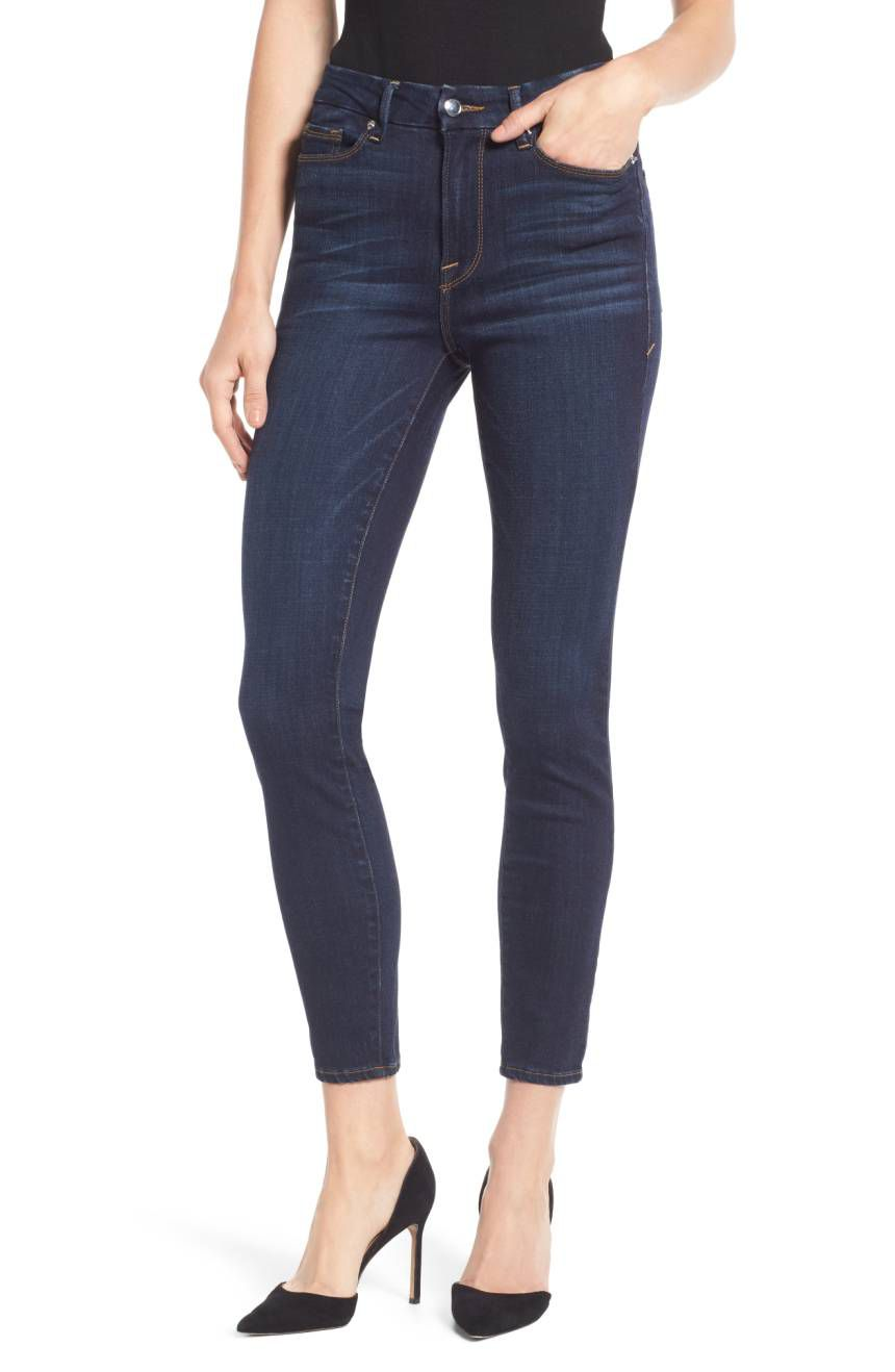 A model in blue skinny jeans
