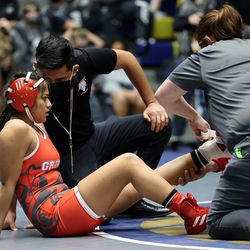 Arleth Antonio of Granger gets her ankle taped as she and Brooklyn Pace of Copper Hills wrestle in class 115 as girls compete for the 6A State Wrestling championship at West Lake High in Saratoga Springs on Monday, Feb. 15, 2021.