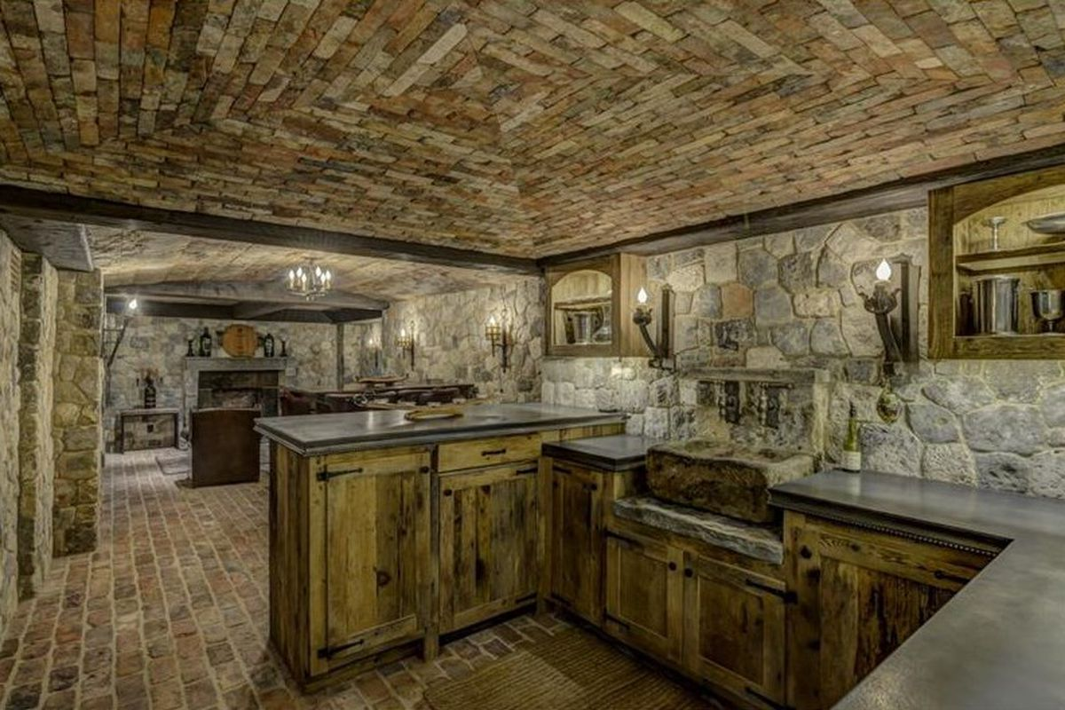 The European-pub style basement of a massive house in Buckhead now for sale.