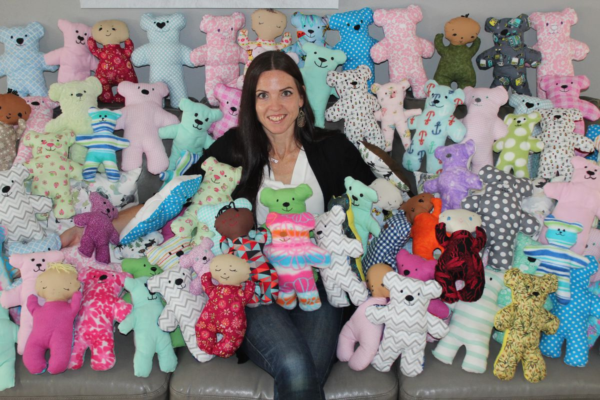 Sarah Carmichael Parson, founder of Dolls of Hope, poses with handmade bears. Since its creation in 2015, Dolls of Hope has donated over 9,000 handmade stuffed toys to children in need all around the world.