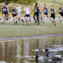 The lead group of runners pass by the duck pond during the 4A Boys State Cross-Country Championships at Sugar House Park in Salt Lake City on Wednesday, Oct. 23, 2019.