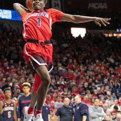 Devonaire Doutrive (1) goes for a cockback one-handed slam during the 2018 Red-Blue dunk contest in McKale Center on October 14 in Tucson, Ariz.