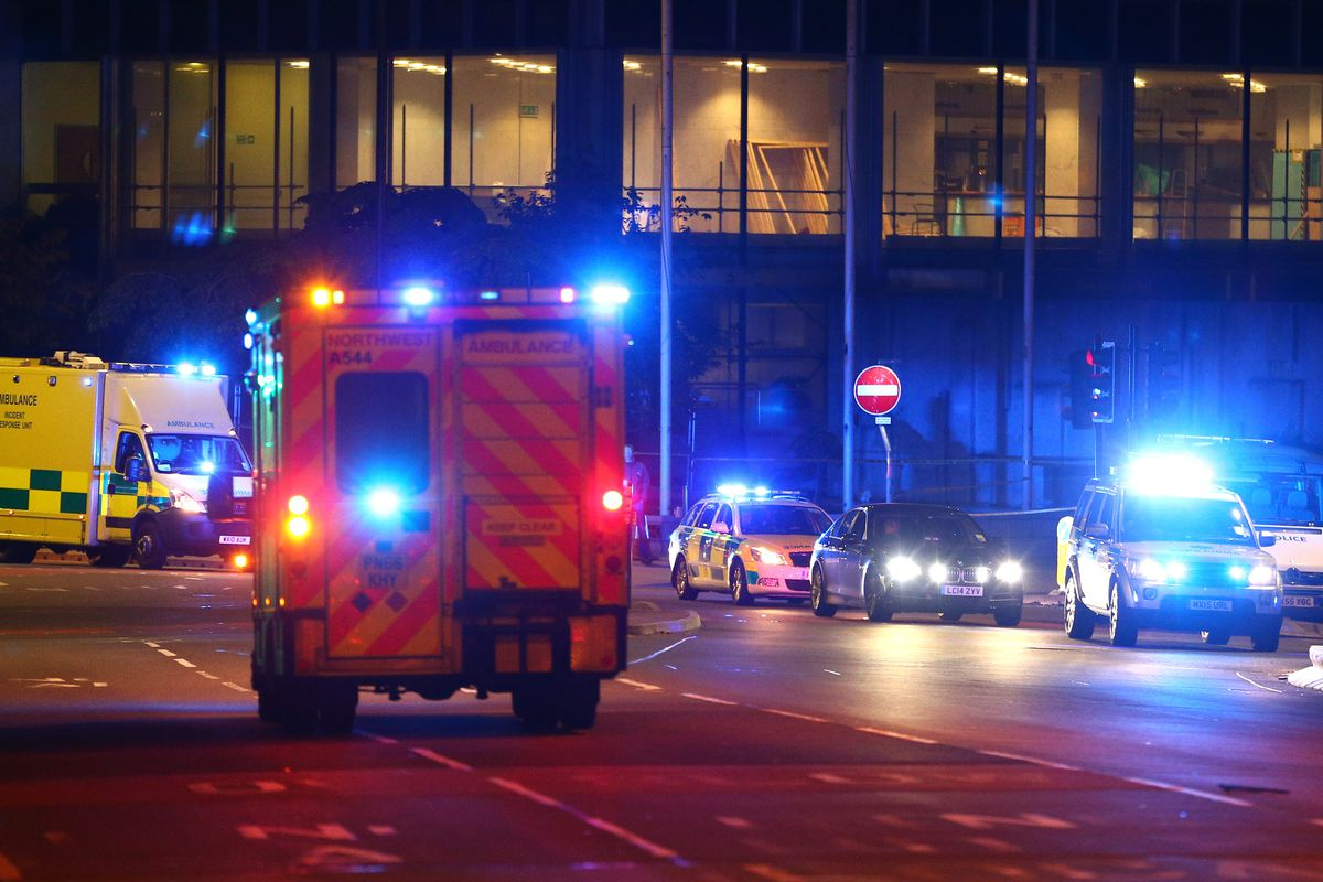 Emergency services arrive close to the Manchester Arena on May 23, 2017 in Manchester, England. There have been reports of explosions at Manchester Arena where Ariana Grande had performed this evening. Greater Manchester Police have have confirmed there a