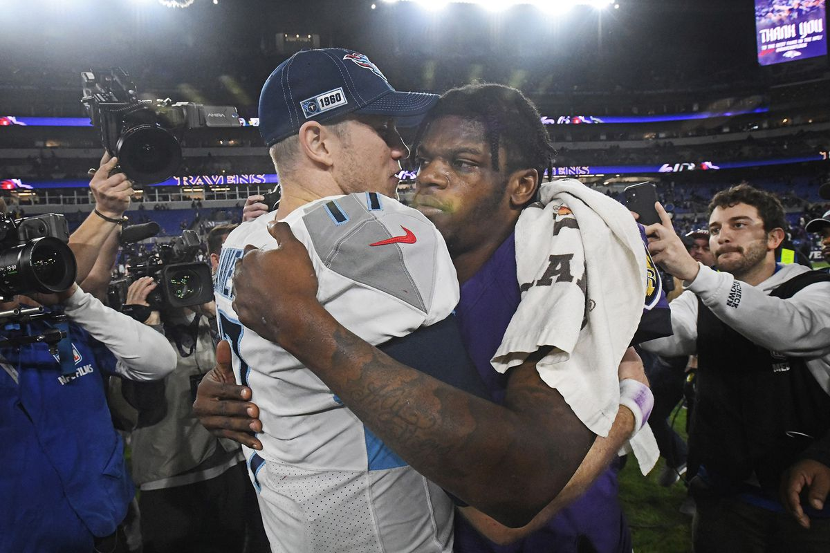 Baltimore Ravens quarterback Lamar Jackson, right, embraces Tennessee Titans quarterback Ryan Tannehill, left, after the AFC Division Playoffs at M&T Bank Stadium in Baltimore on Saturday, Jan. 11, 2020.