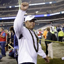 Navy head coach Ken Niumatalolo gestures to fans as he walks off the field after Navy beat Army 21-17 Saturday, Dec. 12, 2015, in Philadelphia.