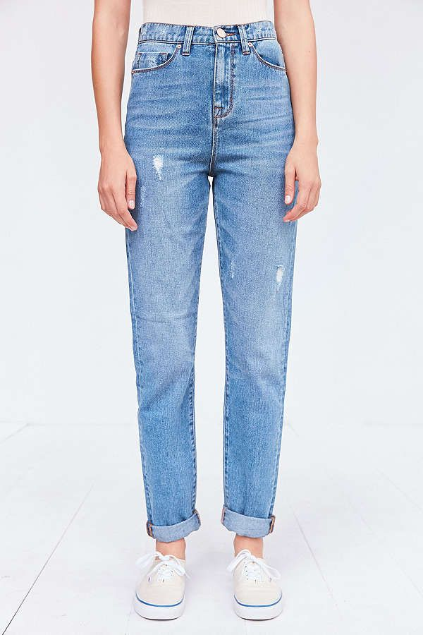 a pair of sightly baggy, distressed denim jeans