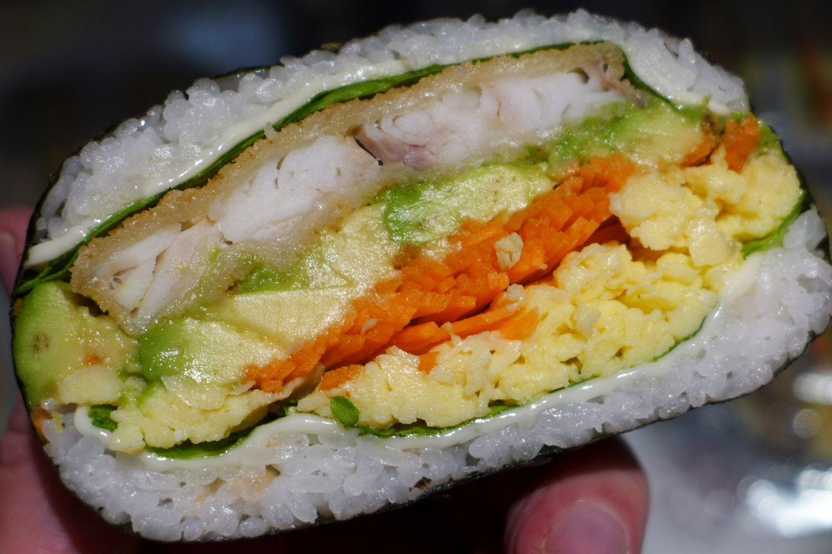 It looks like a sandwich, but maybe it's really a rice ball.