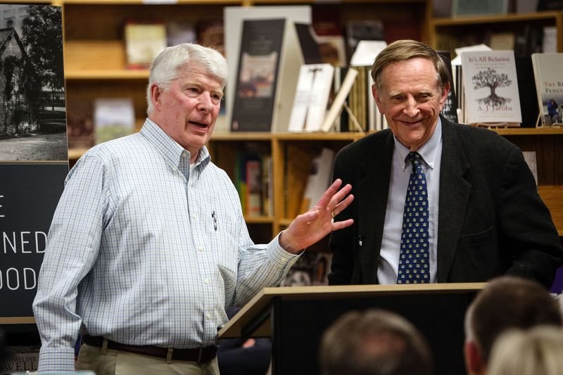 Curt Bench stands with author and historian Richard Bushman at a book signing event at his store Benchmark Books.
