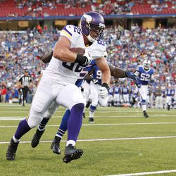 Aug 16, 2013; Orchard Park, NY, USA; Minnesota Vikings tight end Kyle Rudolph (82) runs after a catch against the Buffalo Bills at Ralph Wilson Stadium.