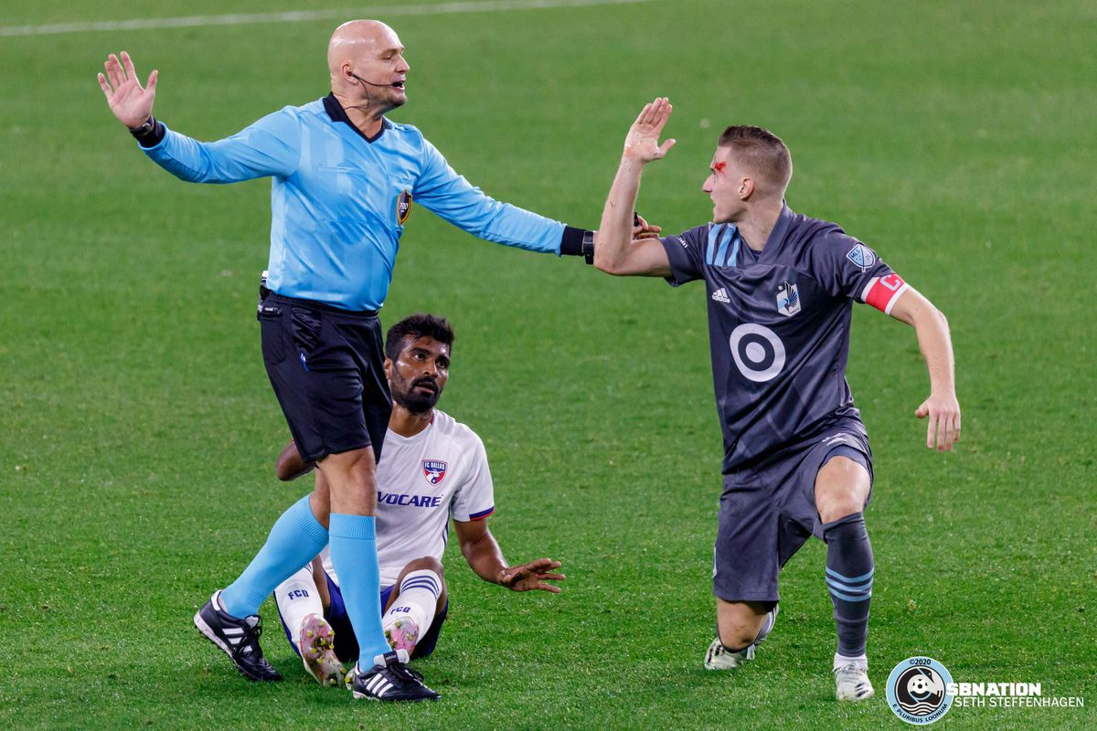 November 8, 2020 - Saint Paul, Minnesota, United States - Minnesota United midfielder Ján Greguš (8) reacts after being cut by FC Dallas defender Thiago Santos (5) during the match at Allianz Field.