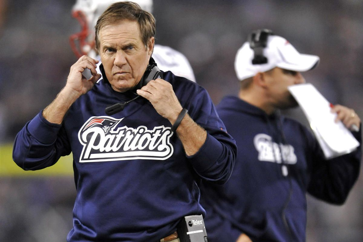 New England Patriots head coach Bill Belichick, left, looks on during the first half of an NFL football game against the Baltimore Ravens in Baltimore, Sunday, Sept. 23, 2012. (AP Photo/Gail Burton)